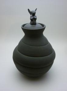 black urn with angel