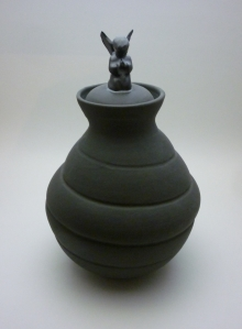 black urn with angel