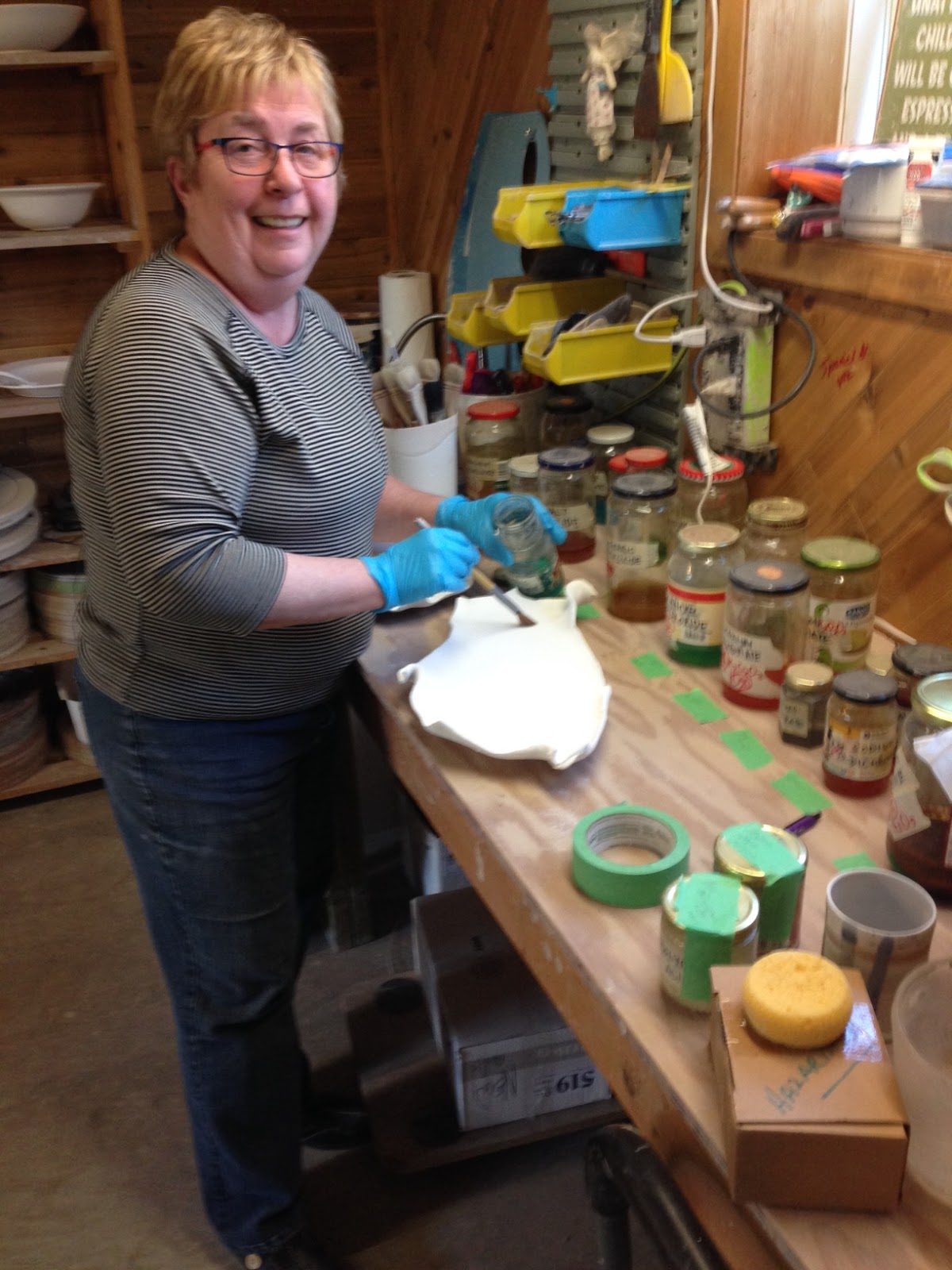 Susan-adding-colorants-to-glazed-pieces.