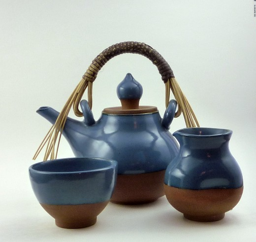 Blue and red clay tea set