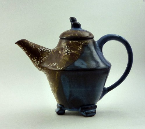 Three footed blue and reticulating teapot